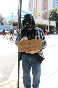 DragonCon is always about fans, and many of them like to produce funny costumes. Here, a down-on-his-luck homeless Darth Vader begs for change for a new Death Star. He was actually making money too!