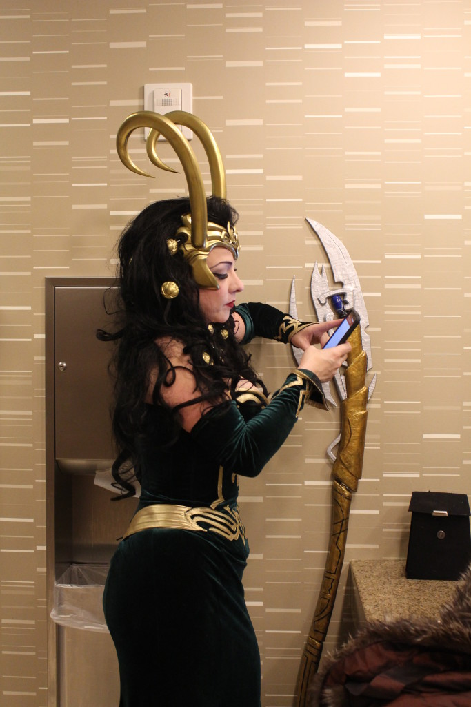 Here Cosplayer Blaze takes on the role of Lady Loki, and takes time out for a text, from Thor perhaps?