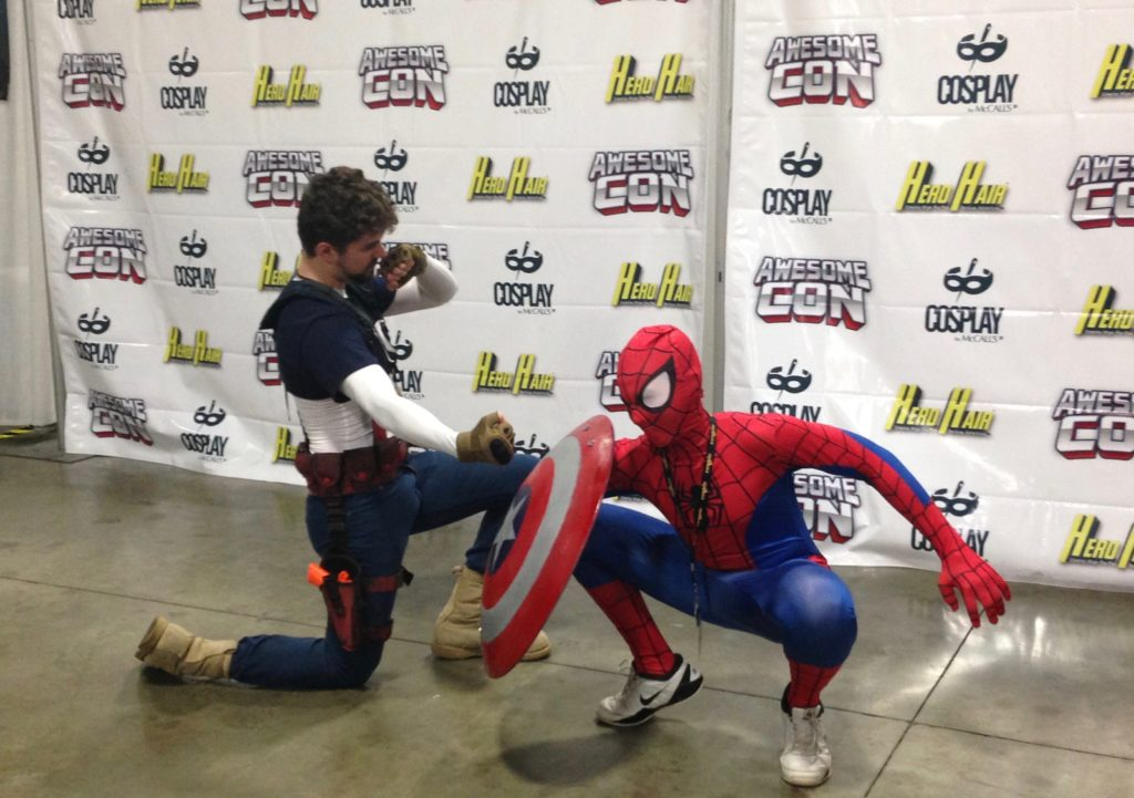 Captain America vs Spiderman from Captain America: Civil War. Cosplayers at the Avengers photo shoot at AwesomeCon 2016.