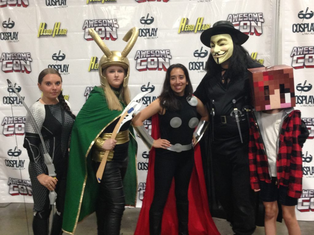 Katniss from the Hunger Games, Loki and Thor, V from V for Vendetta, and a minecraft character. Avengers photo shoot AwesomeCon 2016.