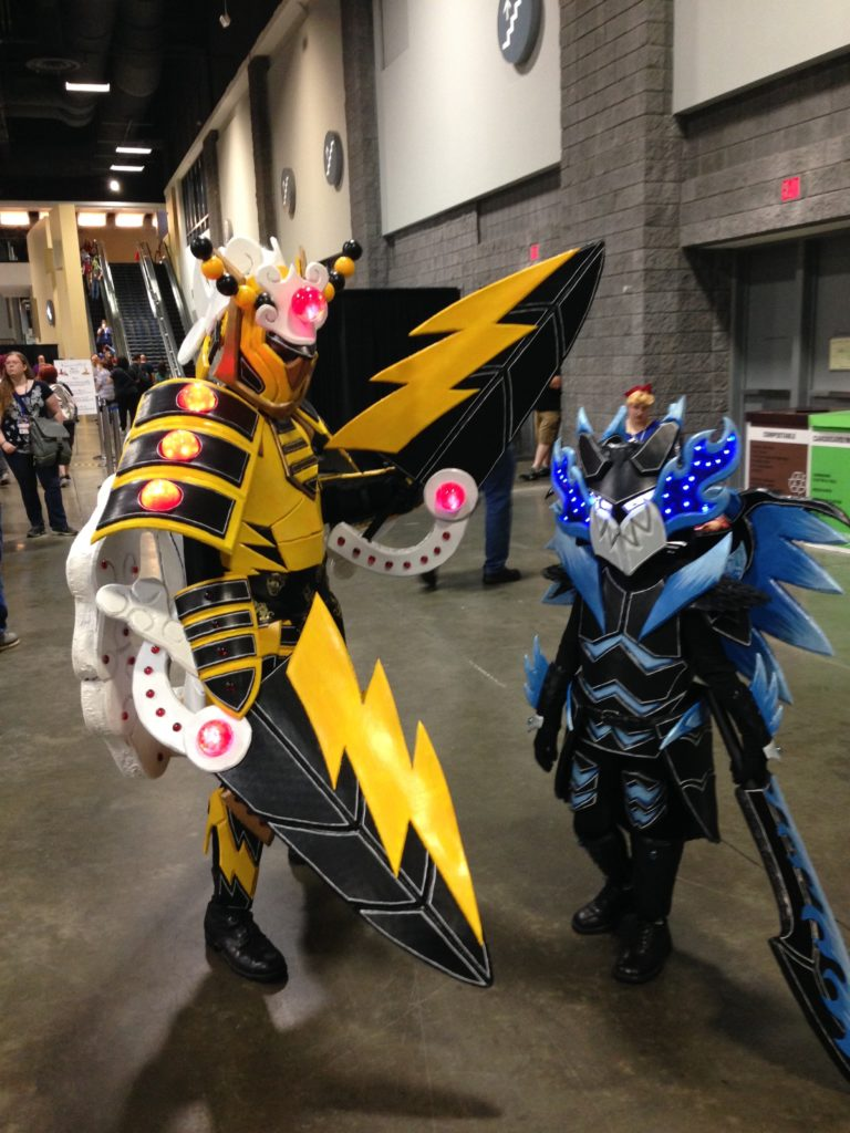 A father and son as two characters from Pokemon monster Hunter Crossover. Nice to see cosplay as a family affair.