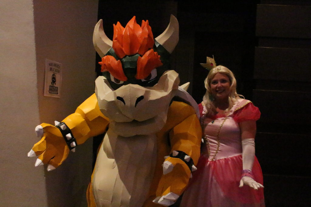 Bowser is escoring Princess Peach. Nothing unusual about that.