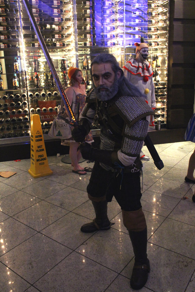 Careful ladies. It's Geralt of Rivia from the Witcher series. His sword even glowed!