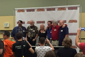 """Story Structure"" panelists pose for photos following the event. Left to right: James Tynion IV, Marv Wolfman, Louise Simonson, Robert Greenberger, Elliot S. Maggin, and Mark Waid."